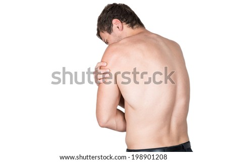 young man has pain in the shoulder