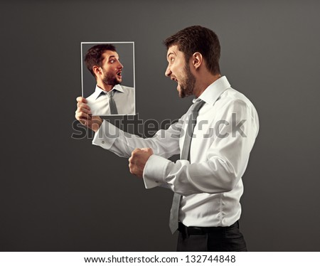 young man have a conflict with himself - stock photo