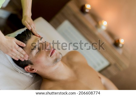 Young man having a facial massage - stock photo