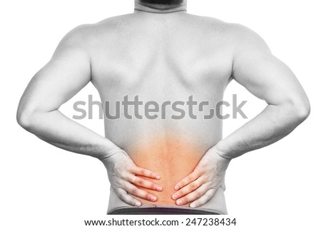 Young man having back pain - stock photo