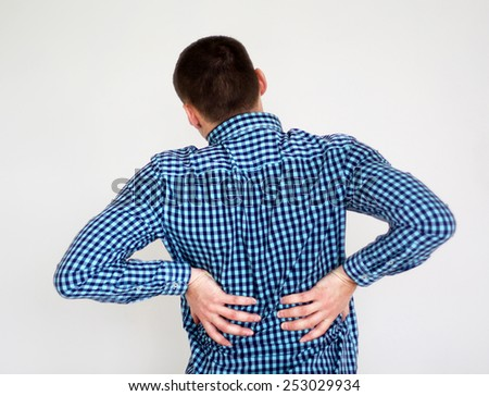 Young man having kidneys pain - stock photo