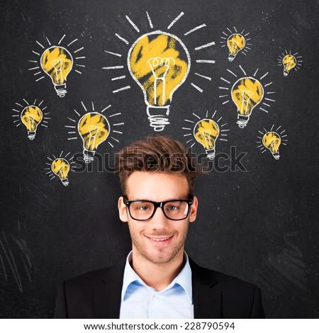 young man having many ideas - stock photo