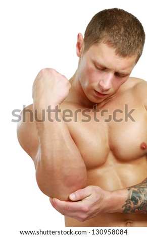 young man having pain in his elbow , isolated on white background - stock photo