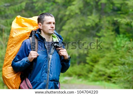 Young man Hiking in in the forest - stock photo