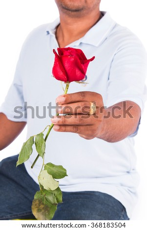young man hold rose flower