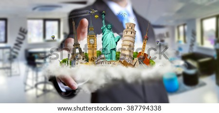 Young man holding a cloud full of famous monuments of the world in his hands - stock photo
