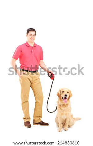 Young man holding a dog on a leash isolated on white background - stock photo