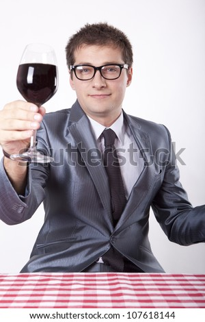 Young man holding a glass of wine. - stock photo
