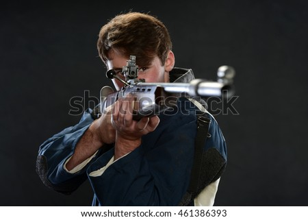 Young Man holding a gun and aiming isolated on a white background