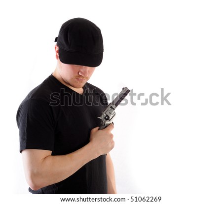 Young man holding a gun, isolated on white