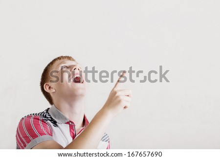 young man holding a hand in his pocket  - stock photo