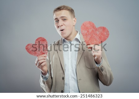 young man holding a heart in his hands