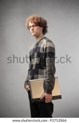 Young man holding a laptop - stock photo