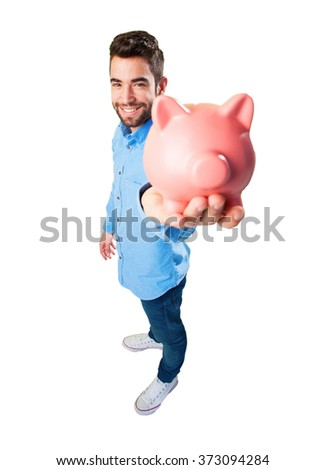 young man holding a piggy bank - stock photo