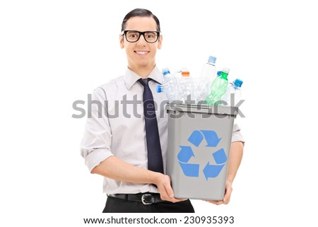 Young man holding a recycle bin full of plastic bottles isolated on white background
