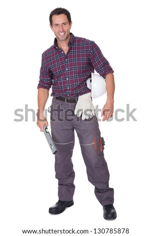 Young Man Holding A Roll Of Blueprints On White Background - stock photo