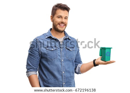 Young man holding a small recycling bin isolated on white background