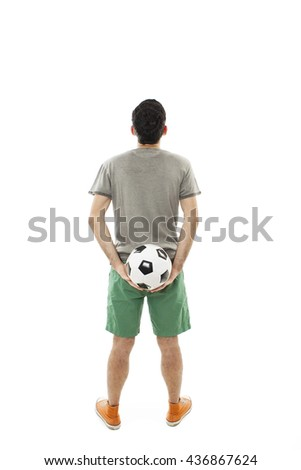 Young man holding a soccer ball looking at wall. Rear view. Isolated on white background  - stock photo