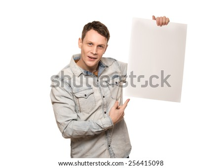 young man holding a white blank board.advertising blank banner - stock photo