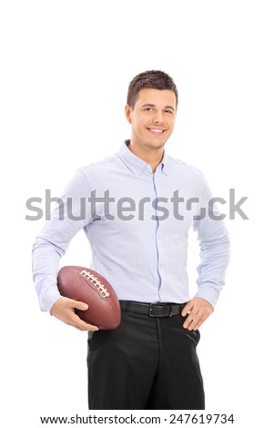 Young man holding an American football isolated on white background - stock photo