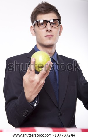 Young man holding an green apple. - stock photo