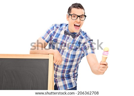 Young man holding an ice cream behind a blackboard isolated on white background - stock photo