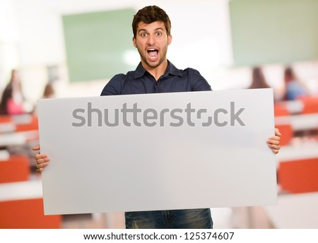 Young Man Holding Banner Gesturing, Indoors
