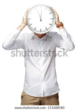 Young Man Holding Big Clock Covering His Face On White Background