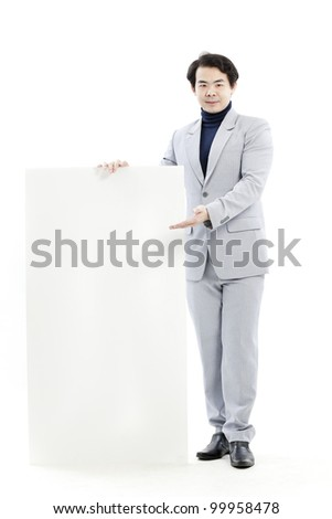 Young man holding blank billboard - stock photo