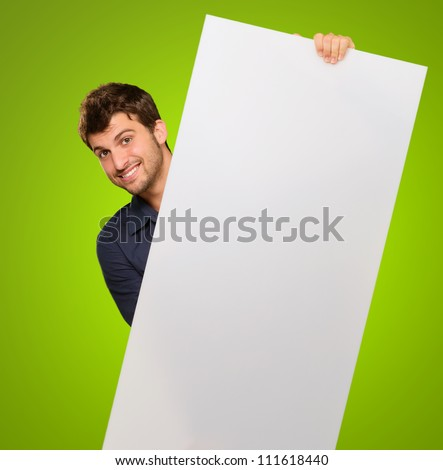 Young Man Holding Blank Paper Isolated On Green Background