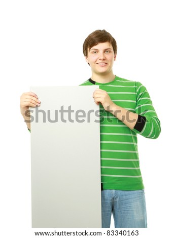 Young man holding blank poster - isolated over white - stock photo