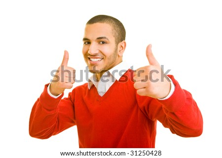 Young man holding both thumbs up - stock photo