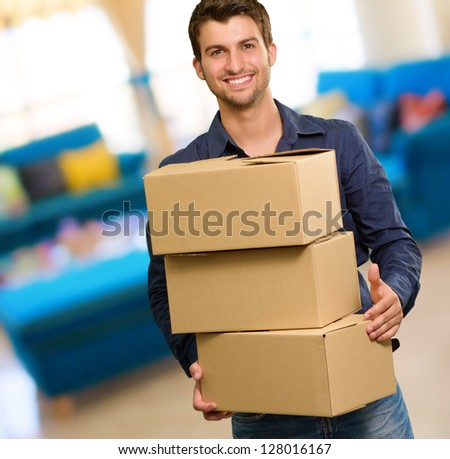 Young Man Holding Card boxes, Indoors