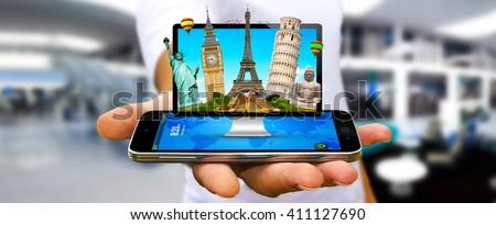 Young man holding computer full of famous monuments of the world in his hands '3D rendering' - stock photo