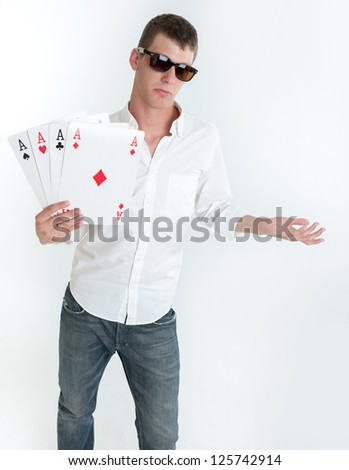 Young man holding four aces