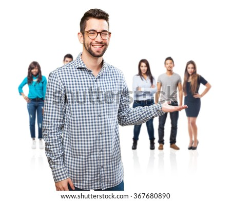 young man holding gesture - stock photo