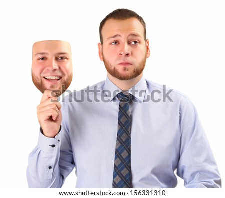 young man holding happy mask - stock photo
