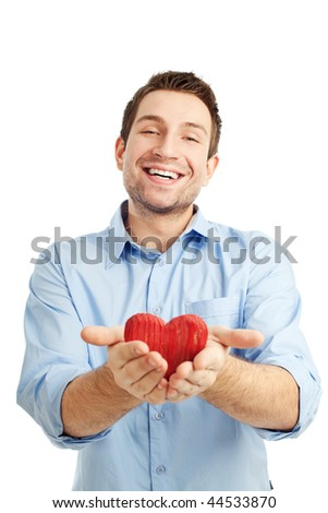 Young man holding heart in his hand. He is giving it somebody. Isolated on white.
