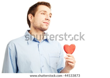 Young man holding heart in his hand. He is giving it somebody. Isolated on white. - stock photo