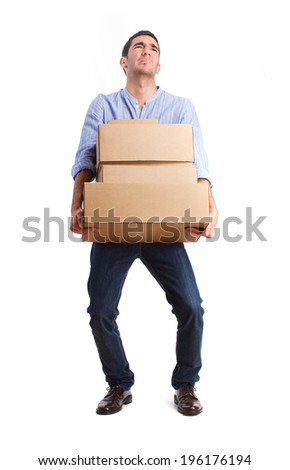 young man holding heavy boxes