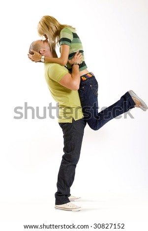 young man holding his girlfriend in the air