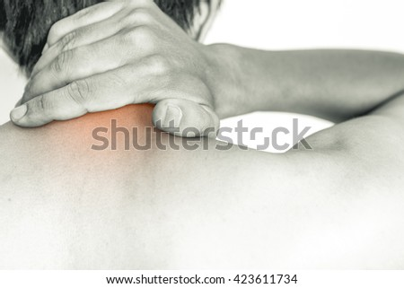 Young man holding his neck in pain, isolated on white background, monochrome photo - stock photo