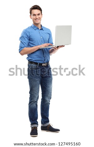 Young man holding laptop - stock photo