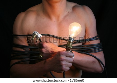 young man holding light bulb