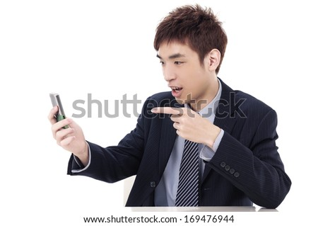 Young man holding mobile phone-close up - stock photo