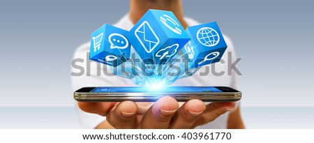 Young man holding modern digital icon application over his mobile phone - stock photo