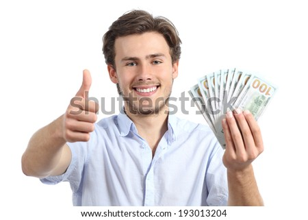 Young man holding money with thumbs up on a white background