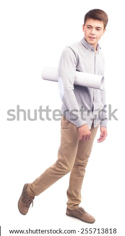 Young man holding paper in studio isolated - stock photo