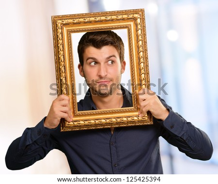 Young Man Holding Picture Frame, Indoor