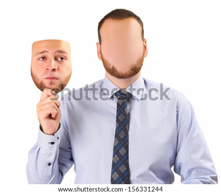 young man holding sad mask - stock photo